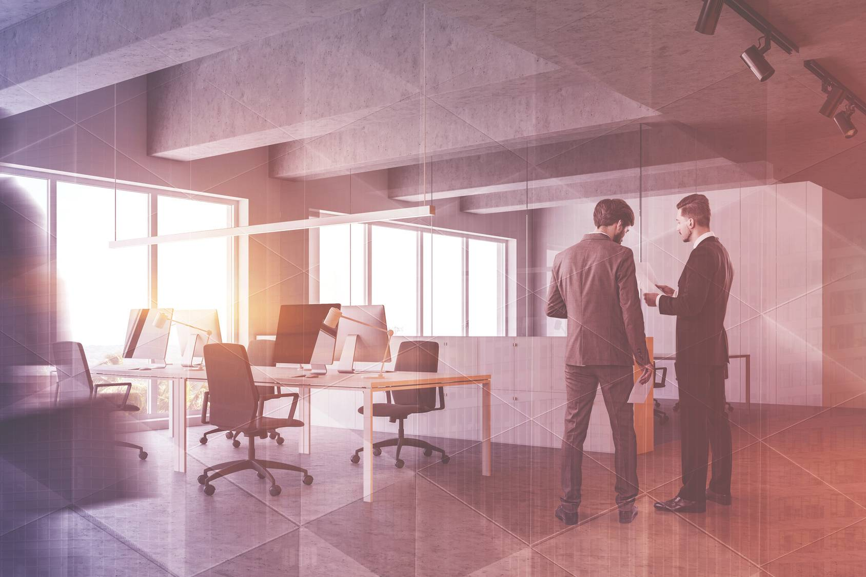 Business people discussing documents in industrial style office with white walls, concrete ceiling and row of white computer desks and file cabinets. Toned image double exposure blurred